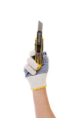 Hand in gloves holds office knife.