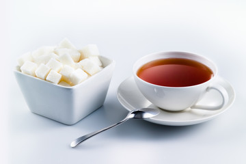 Black tea with sugar cubes