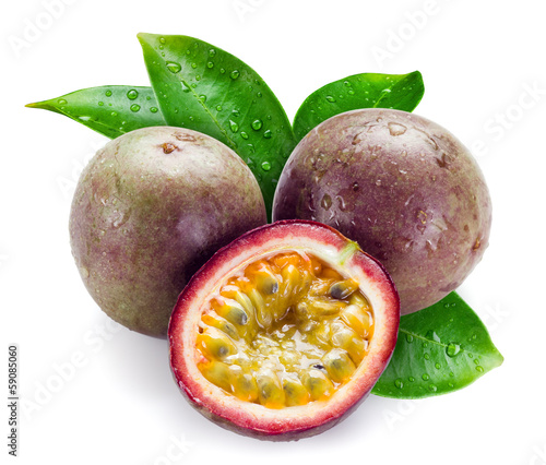 Wet passion fruits with leaves isolated on white