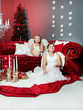 Two cute girls as angels are waiting for Santa Claus