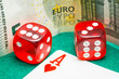 two red dice with euros