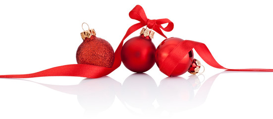 Three Red Christmas balls with ribbon bow Isolated on white back