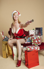 Mrs Santa offering a Christmas cracker