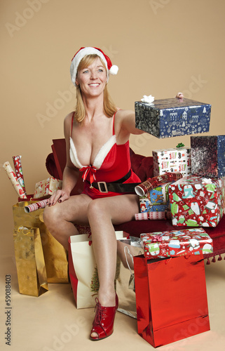 Ms Santa with a Christmas present