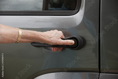Opening car using the door handle
