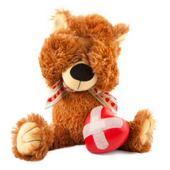 teddy bear with red heart on white