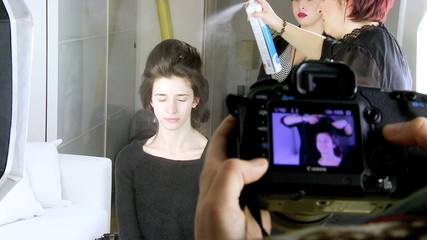 Two hairdresser at work on fashion models hair