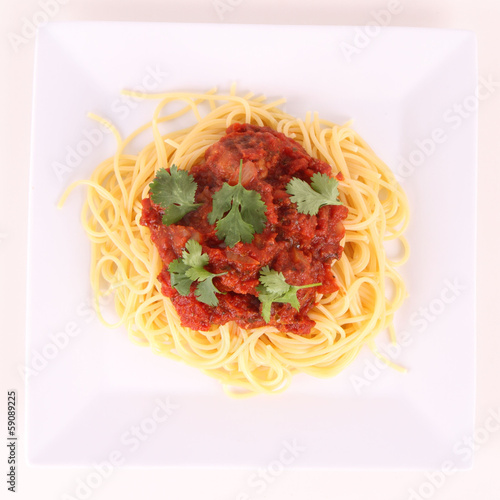 Pasta with meatballs decorated with coriander