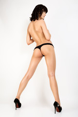 Sexy woman ass in lingerie on white isolated background.