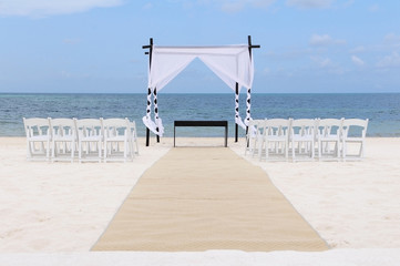Wedding set up on the beach. Canopy, chairs and carpet