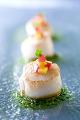 Closeup of gourmet scallop appetizers.