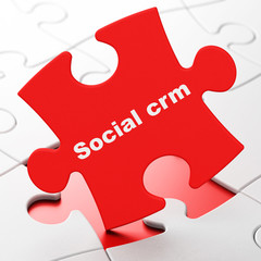 Finance concept: Social CRM on puzzle background