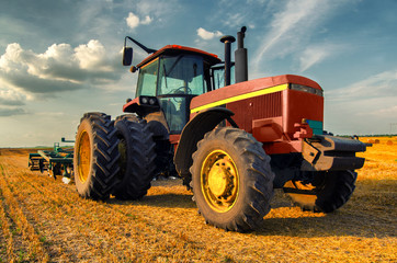 Tractor on the agricultural field