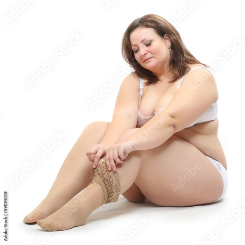 Overweight woman dress in nylons.