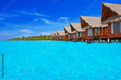 Blue tropical lagoon with water willas on Maldives