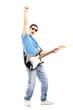 Full length portrait of a happy guy playing an electric guitar