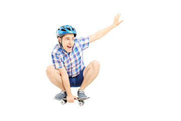 Happy guy with helmet skating on a skate board