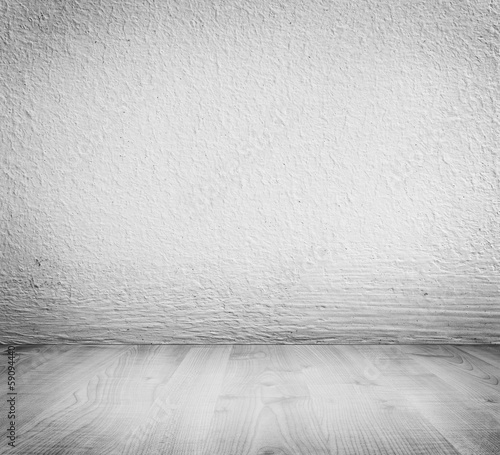 White minimalist plaster, concrete wall background. Wooden floor