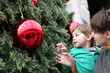 Child with mother at christmas tree