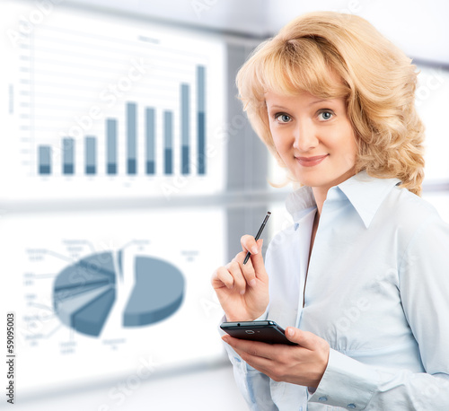 Business woman using her smartphone on the background graphics a