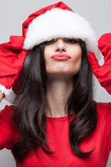 Funny face of girl in santa costume