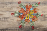 beautiful paper snowflake, on wood background
