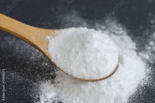 Sodium bicarbonate in a wooden spoon