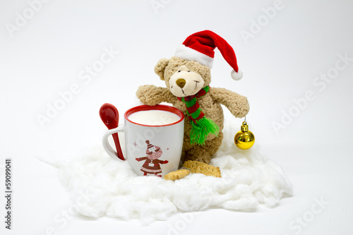 Christmas teddy bear with a cup of milk