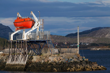 Red rescue boat on the coast in Norwegian town