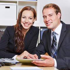 Two happy business people in office
