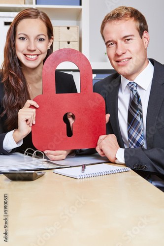 Business people holding lock as security symbol