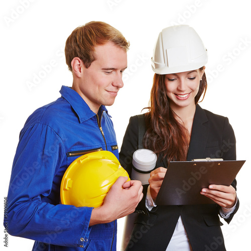 Architect signing bill from construction worker