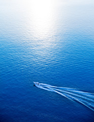 Boat cruising blue Mediterranean sea aerial view