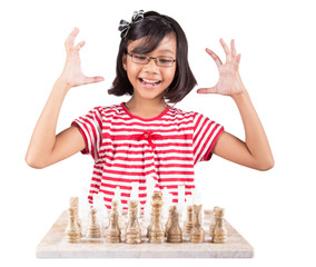 Little girl playing stone made chess set