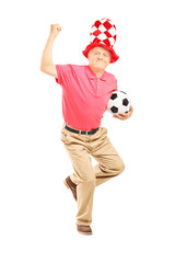 Middle aged sport holding a ball gesturing happiness