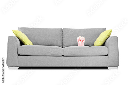 Studio shot of a modern couch with popcorn box on it