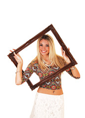 Girl looking trough picture frame.