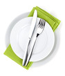 Silverware or flatware set of fork, spoons and knife on plates - 59104250