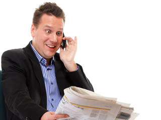 man looks surprised while reading a newspaper