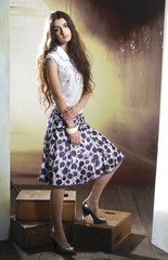 young girl with long hair is in fashion style posing