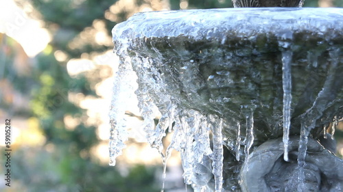 Ice Melting from a Frozen Fountain on a Cold Winter Day