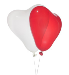 isolated white and red heart shape balloons
