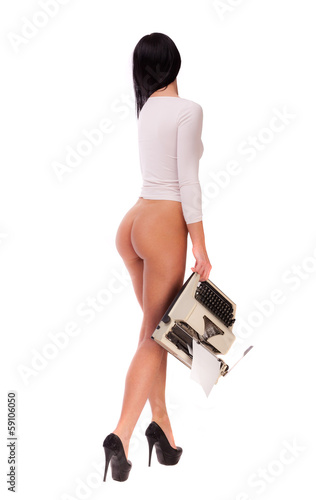 Half-naked brunette with a typewriter on a white background.