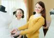 pretty bride chooses bridal dress
