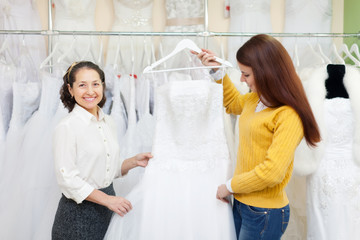 women   at shop of wedding fashion