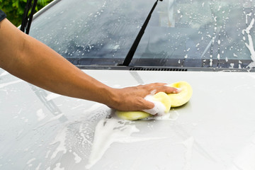 man and sponge for cleaning car and washing car