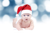 Baby in New Years hat on the bokeh background