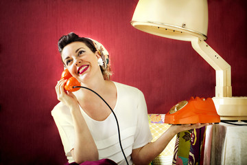 vintage housewife chats on the phone in Hair salon
