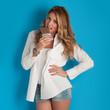 Sensual blonde woman holding chocolate bar against blue backgrou