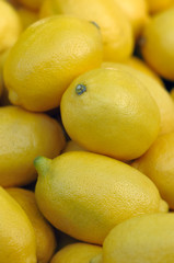 Full raw and ripe lemons on display close up